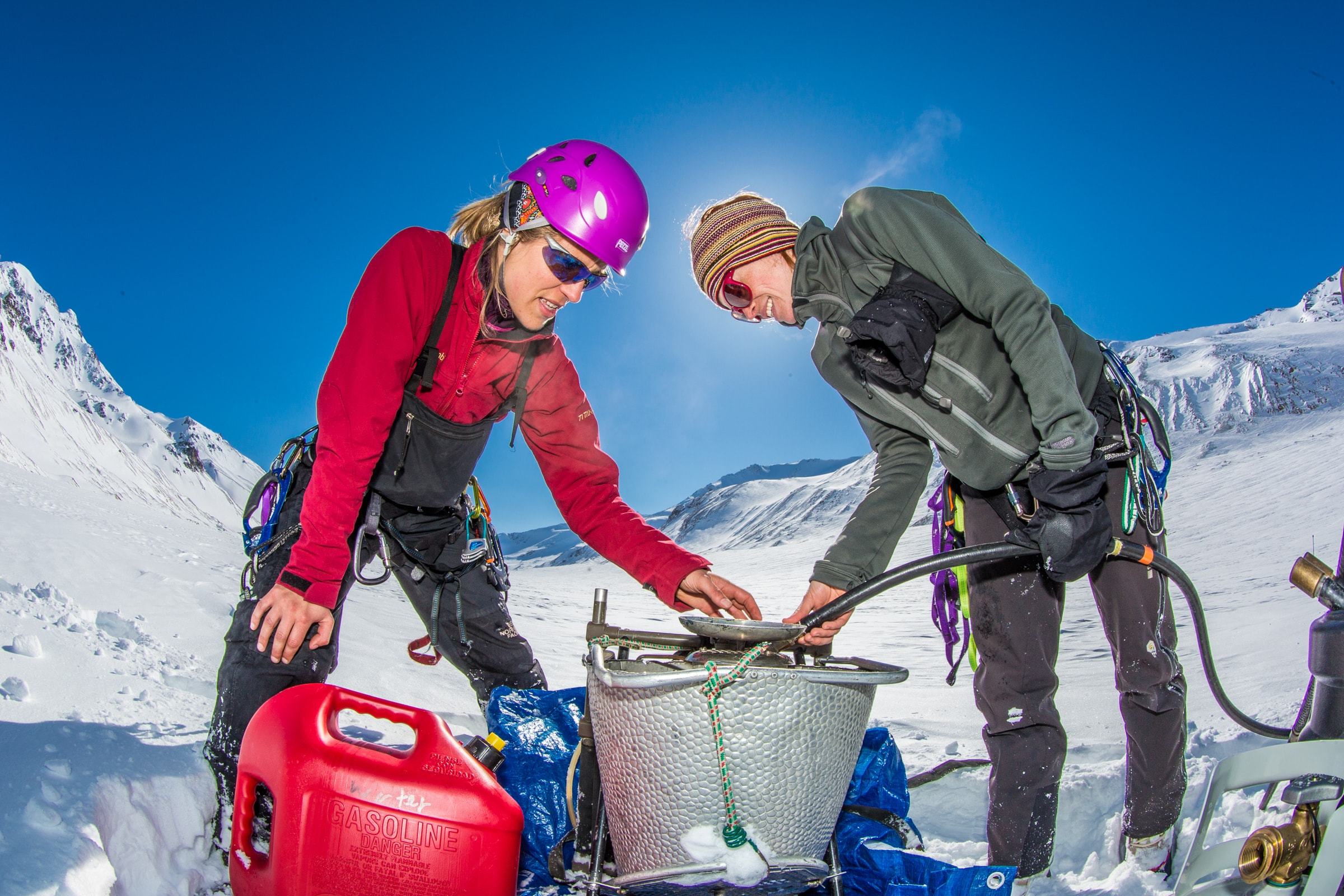 Research Assistant Professor Anna Liljedahl, left, and graduate student Joanna Young set up a steam drill used to install stakes for measuring glacier melt on the Jarvis Glacier, about 35 miles south of Delta Junction. PC: Todd Paris, University of Alaska Fairbanks Photo