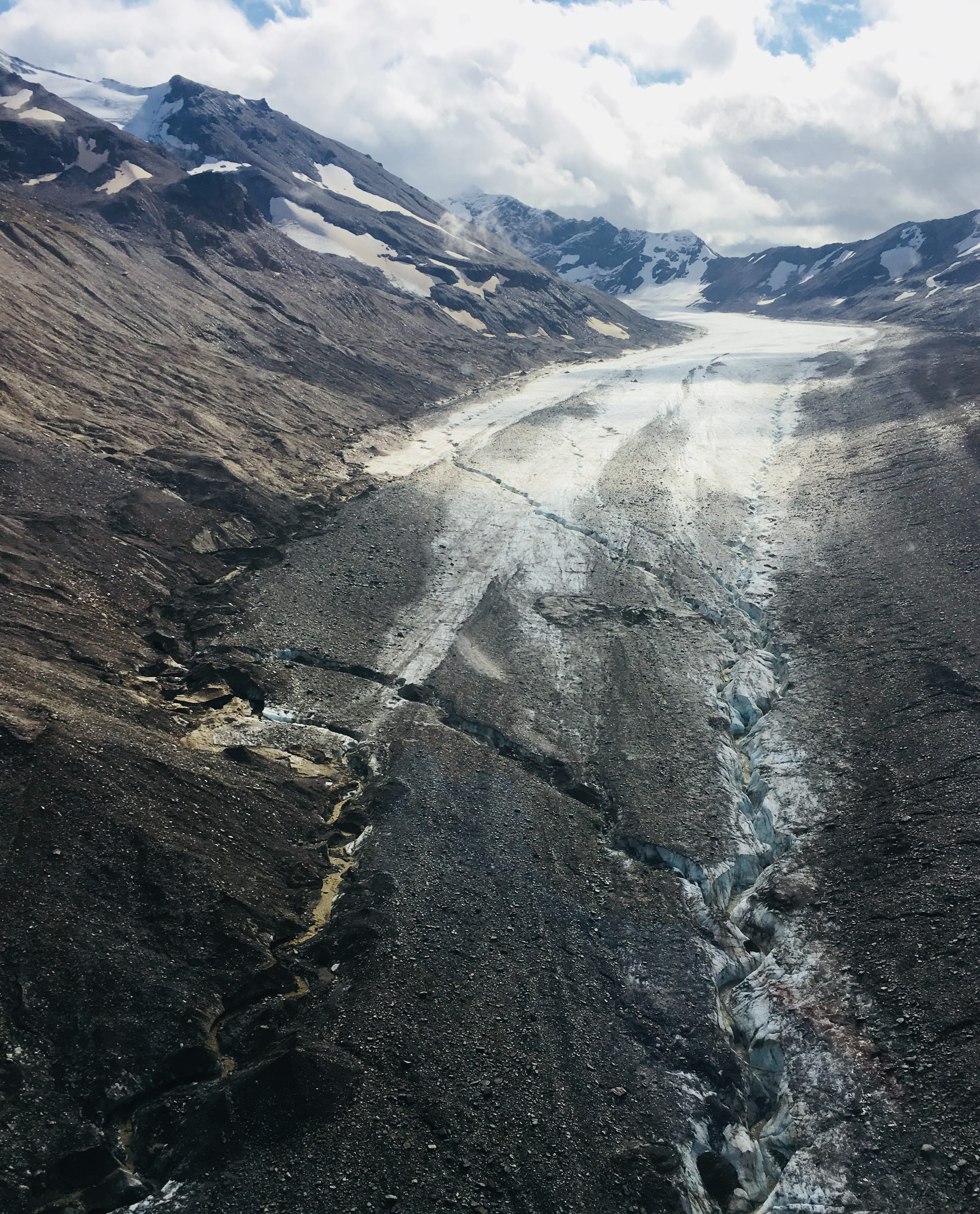 Jarvis Glacier and its debris field in August 2018. The bare ice surface has retreated over one mile since the late 1940's. P.C. A. Liljedahl