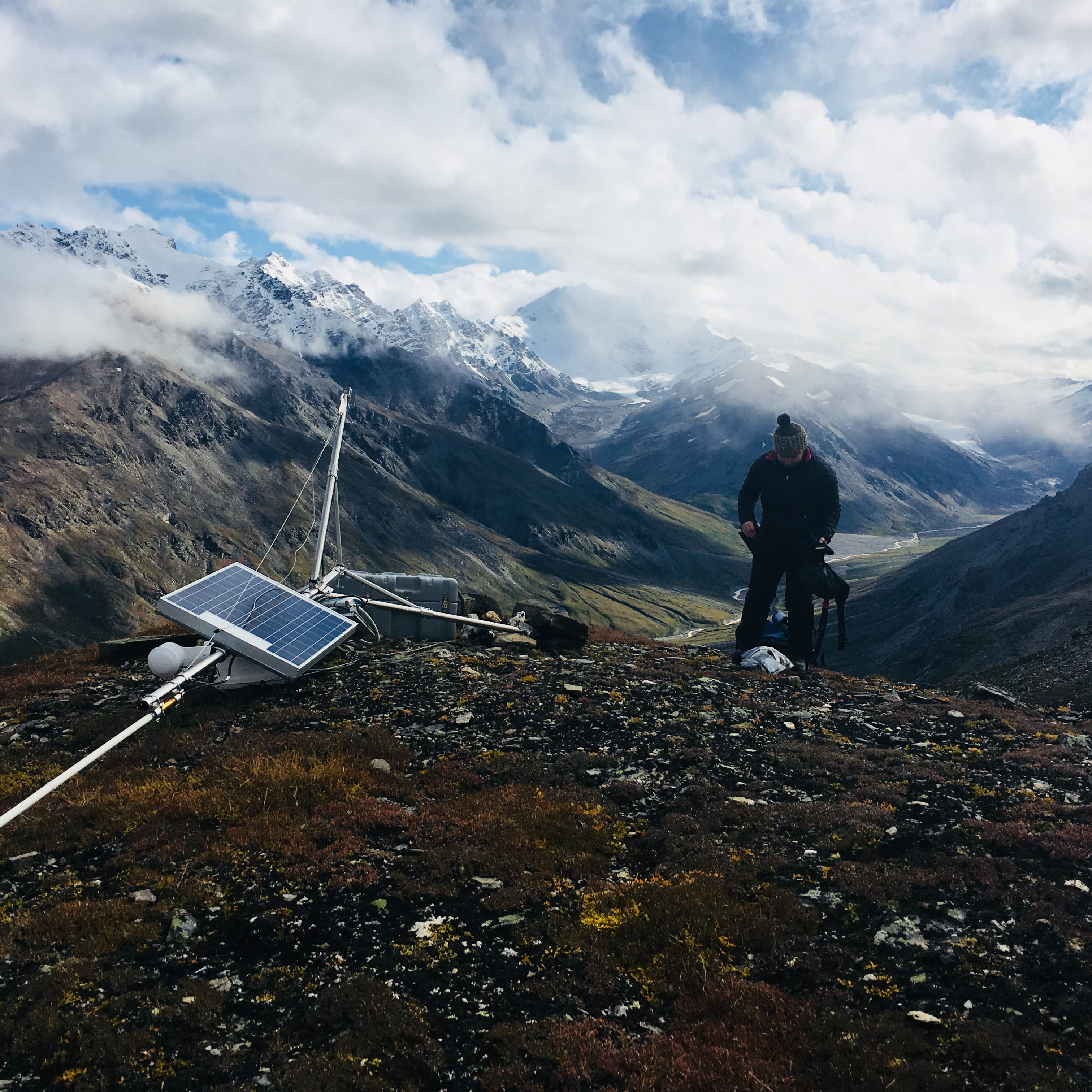 Research Professional Emily Youcha working on the repeater site, which allows weather data from the Jarvis Glacier meteorological station (1750 meters above sea level) to be transmitted to the cellular network. PC: A. Liljedahl