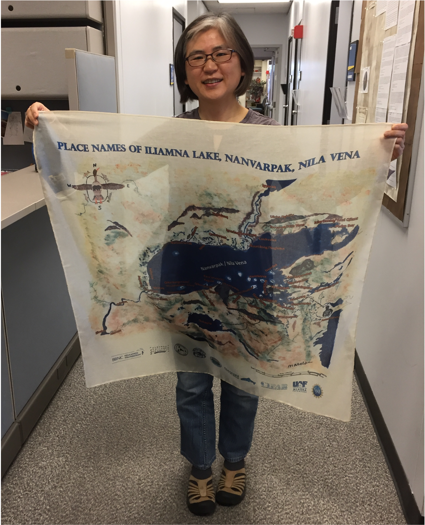 Dr. Yoko Kugo with her scarf depicting a map of Iliamna Lake with local place names.